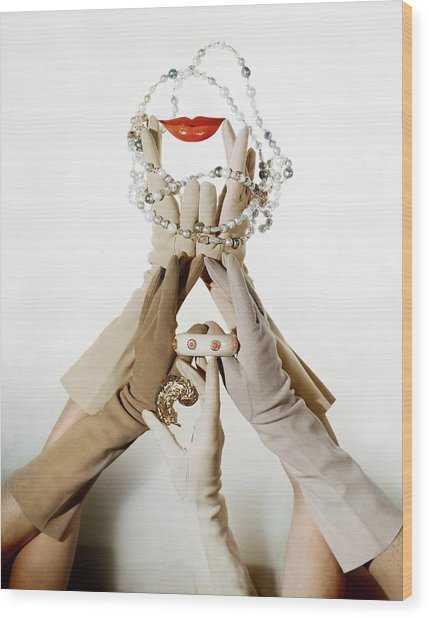 Gloved Hands Holding Jewelry Wood Print by John Rawlings