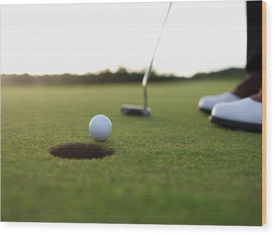 Golf Ball At Edge Of Hole On Green Wood Print