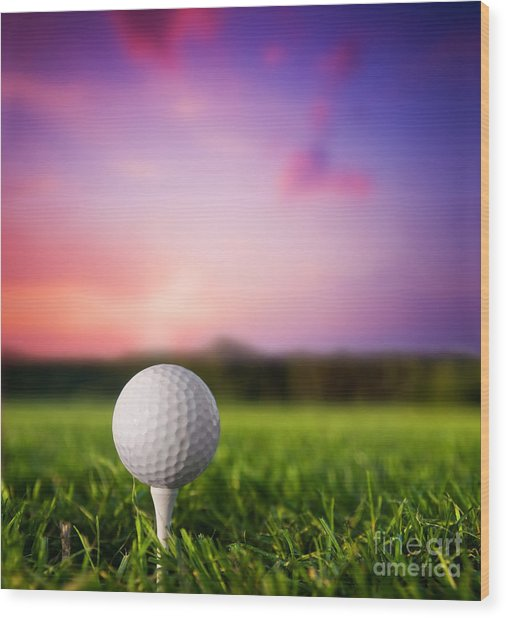 Golf Ball On Tee At Sunset Wood Print