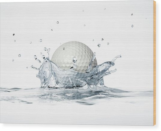 Golf Ball Splashing Into Water Wood Print by Leonello Calvetti