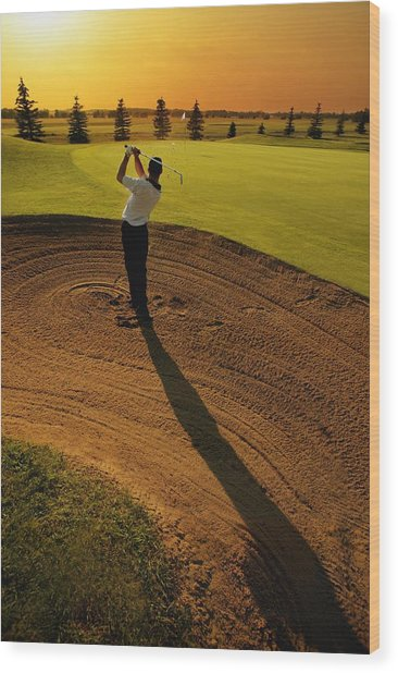 Golfer Taking A Swing From A Golf Bunker Wood Print