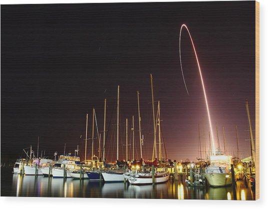 Gps Launch Over The Marina Wood Print by John Moss