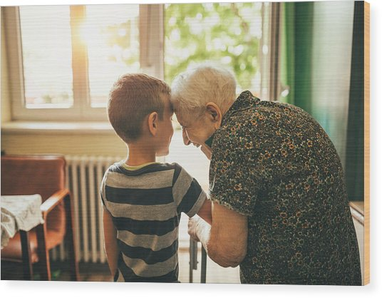 Grandson Visiting His Granny In Nursery Wood Print by Supersizer