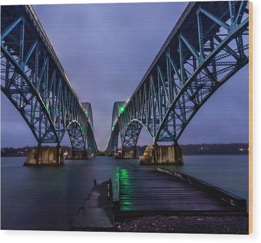 Green Light On The Pier Below Twin Spans On A Misty Dawn Wood Print