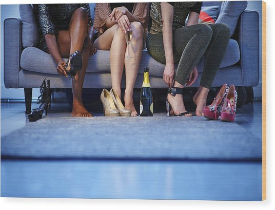 Group Of Women Putting On Heels Before Night Out Wood Print by Mike Harrington