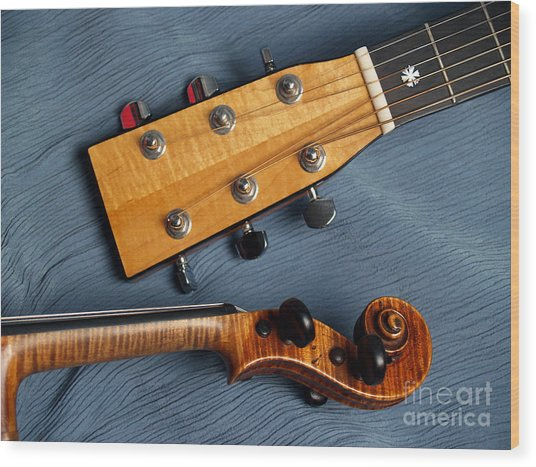 Guitar And Violin Heads On Blue Wood Print by Anna Lisa Yoder