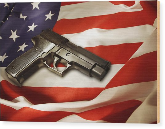 Gun On Flag Wood Print