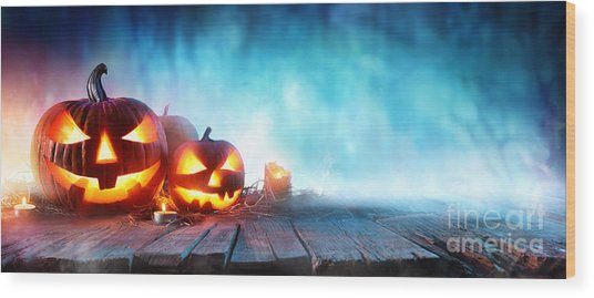 Halloween Pumpkins On Wood In A Spooky Wood Print by Romolo Tavani
