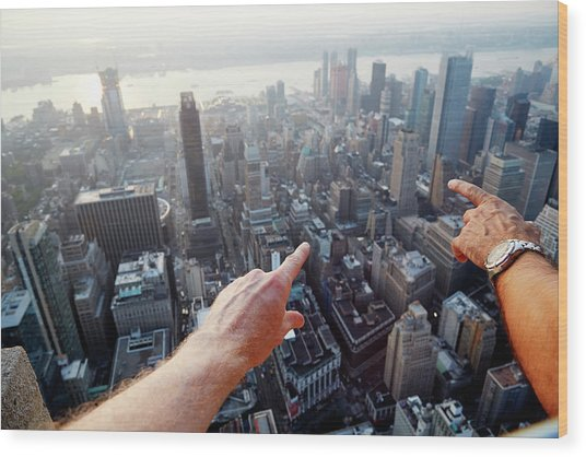 Hands Pointing At City As Seen From Wood Print by Chris Tobin
