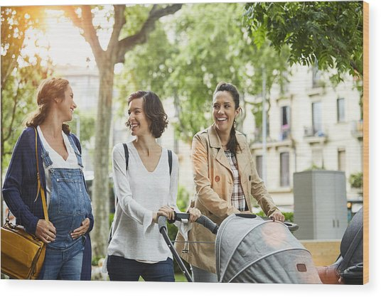 Happy Pregnant Woman With Friends In Park Wood Print by Morsa Images