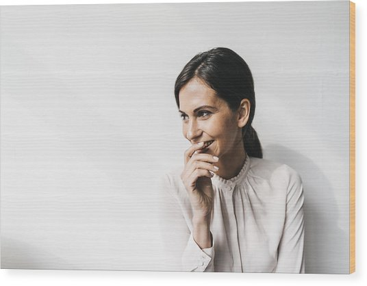 Happy Woman In Front Of White Wall Wood Print by Westend61