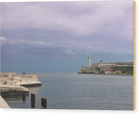 Havana Malecon With Morro Lighthouse And A Lonely, Unrecognizable Person Relaxing By The Sea, Cuba Wood Print by Smartshots International