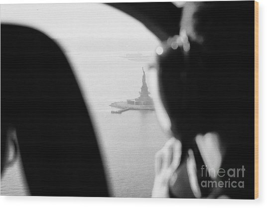 Helicopter  Flies Over Statue Of Liberty As Seen Through The Plexiglas New York Wood Print by Joe Fox