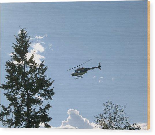 Helicopter Misses Tree Wood Print by Mavis Reid Nugent