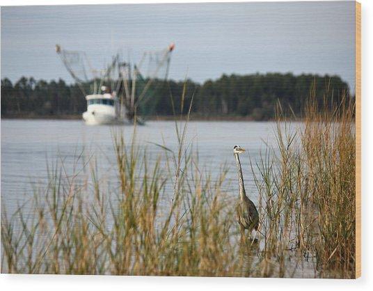 Heron Wading With Passing Shrimp Boat Wood Print