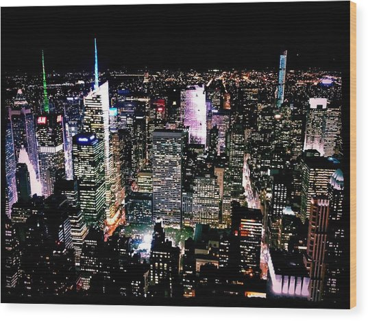 High Angle View Of Cityscape Lit Up At Wood Print by Paolo Tahalele / Eyeem
