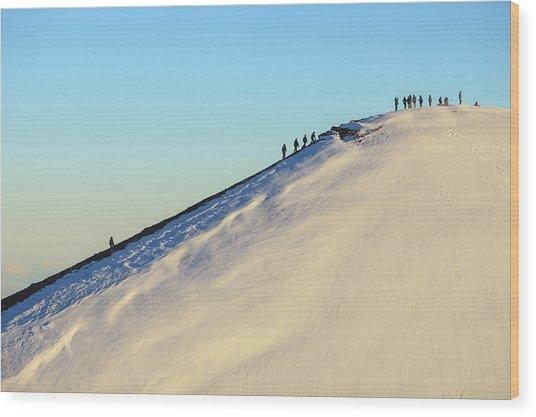 Hikers Climbing Snowy Mountain Wood Print
