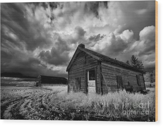 Homestead Under Stormy Sky Wood Print