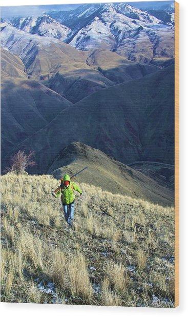 Hunter Climbing Steep Hillside Wood Print