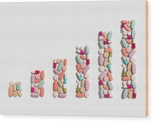 Illustration Of Rising Cost Of Prescription Drugs Wood Print by Fanatic Studio / Science Photo Library