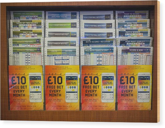Inside A William Hill Plc Betting Shop As The Rank Group Plc And 888 Holdings Plc Mull Possible Joint Takeover Offer Wood Print by Bloomberg