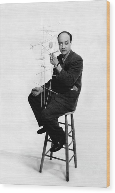 Isamu Noguchi Holding One Of His Structures Wood Print by Herbert Matter