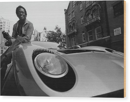 Jazz Musician Miles Davis Sitting On The Hood Wood Print