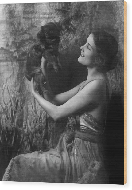 Jeanne Eagels Lifting Up A Small Dog Wood Print