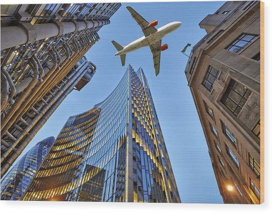 Jet Plane Flying Low Over Three Different Kind Of Architecture by Pbombaert