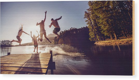 Jumping Into The Water From A Jetty Wood Print by Wundervisuals