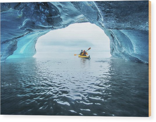 Kayak In Ice Cave Wood Print by Piriya Photography