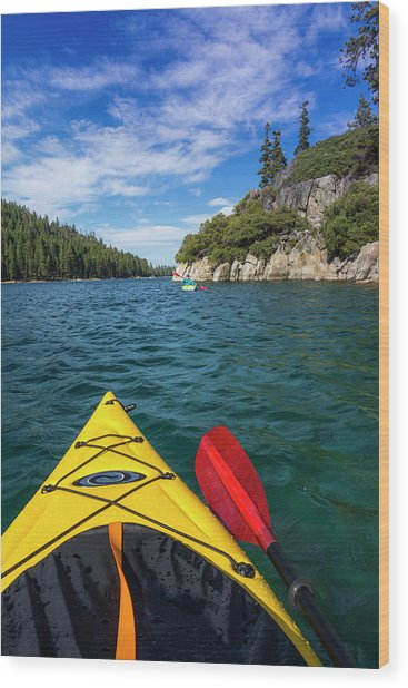 Kayaking In Emerald Bay At Fannette Wood Print by Russ Bishop