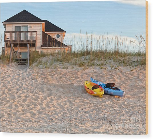 Kayaks Rest On Sand Dune In Morning Sun. Wood Print