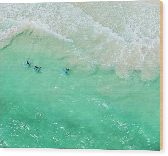 Kids Playing In The Waves On Tropical Wood Print