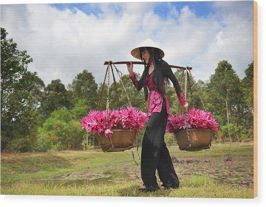 Lady Caries Lotus Flowers Wood Print