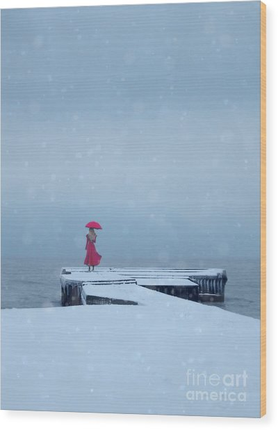 Lady In Red On Snowy Pier Wood Print