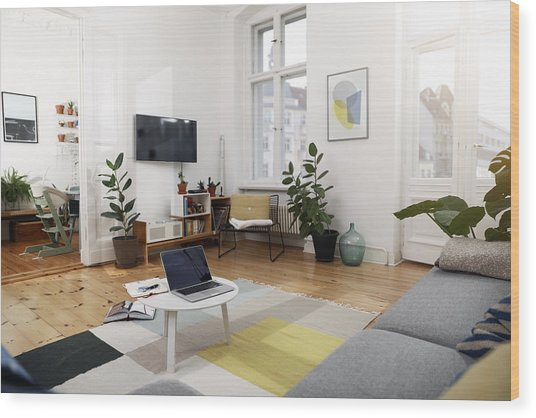 Laptop On A Coffee Table In A Modernly Furnished Flat Wood Print by Westend61