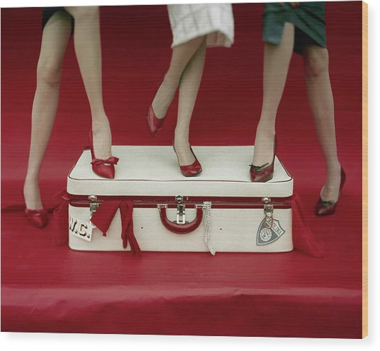 Legs Of Models Standing On A Suitcase Wood Print by Sante Forlano