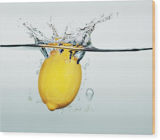 Lemon Splashing In Water Wood Print by Martin Barraud