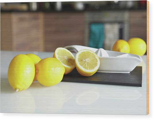 Lemons And Juicer On Kitchen Counter Wood Print by Debby Lewis-harrison