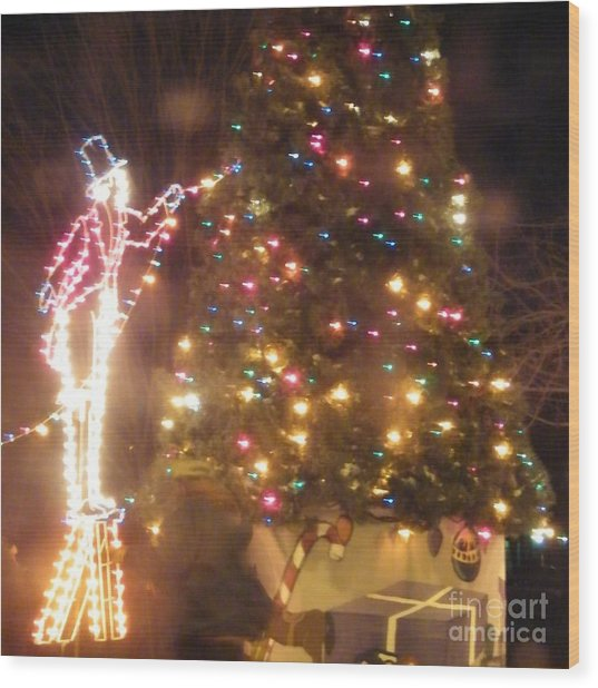 Lighted Decorating Of Tree Wood Print