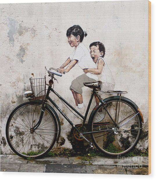 Little Children On A Bicycle Wood Print by Donald Chen