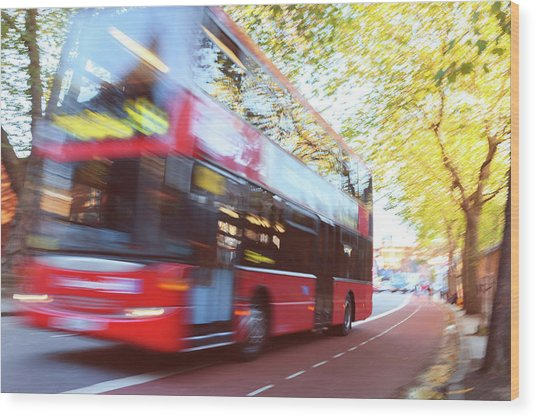 London Red Double Decker Bus Driving At Wood Print by Pavliha