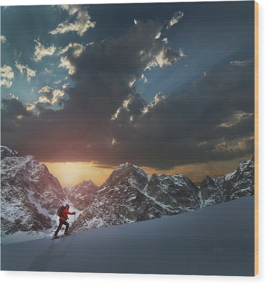 Lone Climber On A Snowy Slope At Sunrise Wood Print