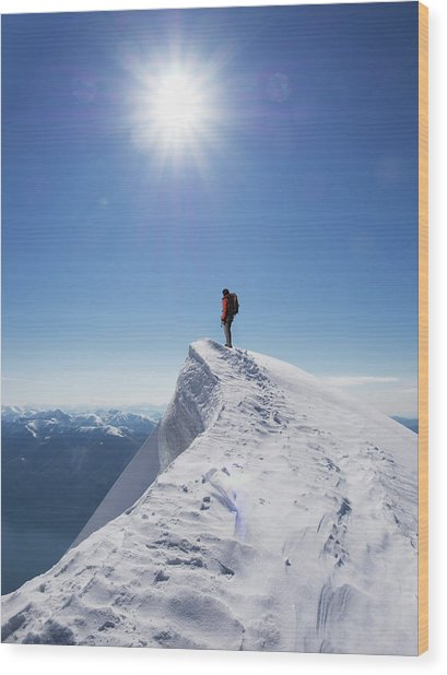 Lone Climber On The Top Of A  Mountain Wood Print by Buena Vista Images