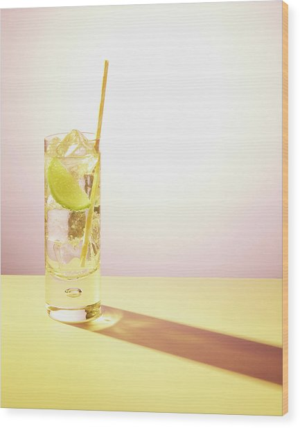 Long Drink In Glass With Lime And Straw Wood Print by Felicity Mccabe