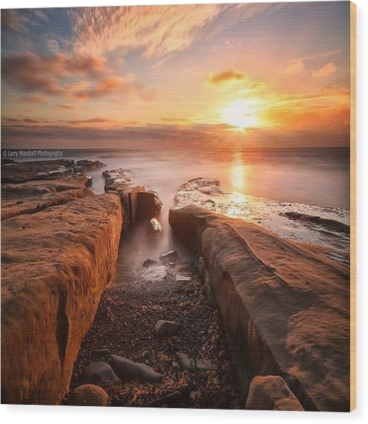 Long Exposure Sunset At A Rocky Reef In Wood Print by Larry Marshall