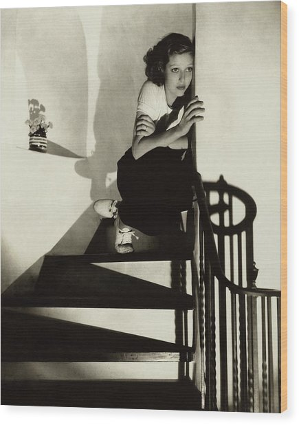 Loretta Young Sitting On A Staircase Wood Print