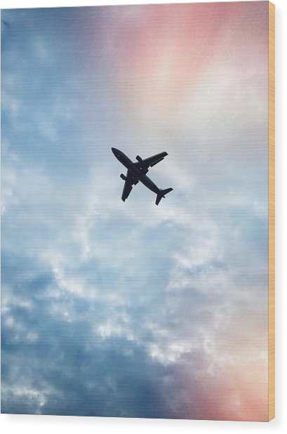 Low Angle View Of Airplane Flying In Wood Print by Maurice Rivera / Eyeem