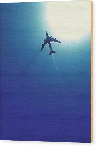 Low Angle View Of Airplane In Flight Wood Print by Karla Peña / Eyeem